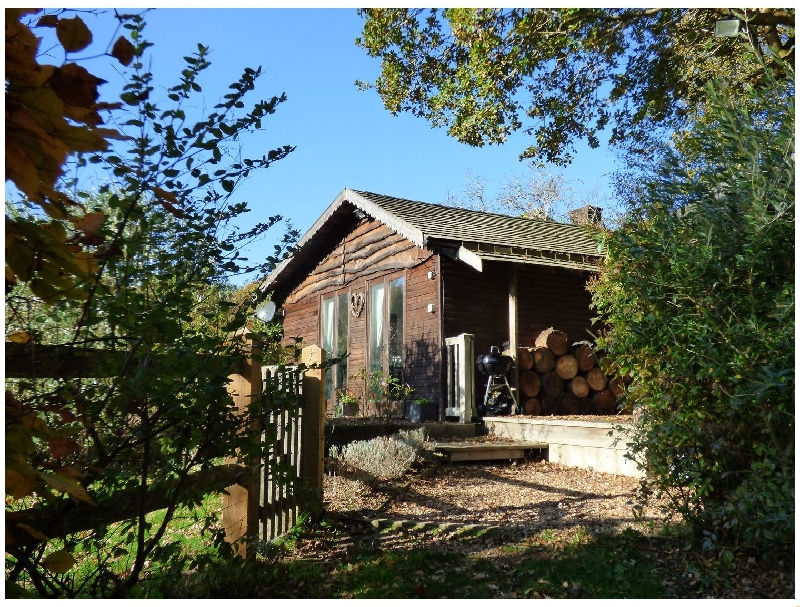 Click here for more about Woodmancote Lodge